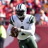 Michael Vick, then of the New York Jets runs the ball against the Kansas City Chiefs during a game at Arrowhead Stadium on November 2, 2014 in Kansas City, Missouri.