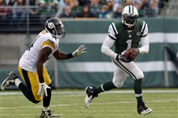 Jets quarterback Michael Vick tries to evade the Steelers' Lawrence Timmons as he carries in the third quarter during a game at MetLife Stadium in November. Vick threw two touchdown passes in the Jets' victory.
