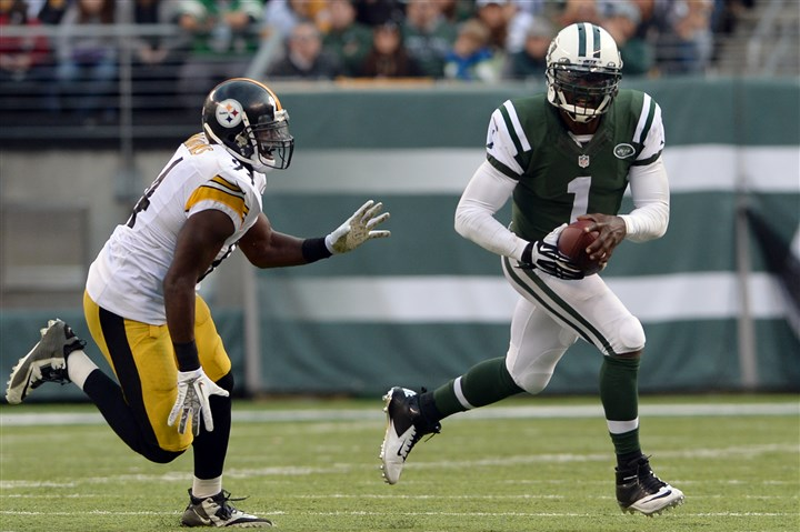 20141109mfsteelerssports18-1 Jets quarterback Michael Vick tries to evade the Steelers' Lawrence Timmons as he carries in the third quarter during a game at MetLife Stadium in November. Vick threw two touchdown passes in the Jets' victory.