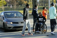 Leon Ford, center, and supporters chant and block traffic on Penn Avenue in front of Bakery Square in 2014 on the second anniversary of Mr. Ford being shot and paralyzed during a traffic stop.