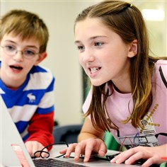 "20141110jrDigitalCorpsNorth2-1 Hunter Hoose, 11, and Ilijana Hasak, 11, work on their ""dragon with a unicorn head"" robot."