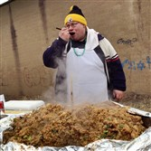 Chef Leonard Pisano samples his jambalaya during an outdoor event on the South Side on St. Patrick's Day, 2014.
