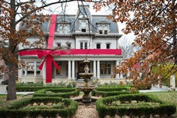A huge bow wraps up the the Negley-Gwinner-Harter mansion, which will be on the Shadyside Splendor house tour to benefit  the Pittsburgh Symphony Orchestra.