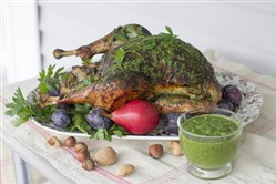 Herb roasted Thanksgiving turkey. The inspiration for the turkey came from South American chimichurri, a richly herbed sauce that pairs beautifully with roasted meats.