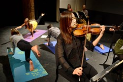 Yejee Kim, a 26-year-old master's student at Carnegie Mellon University, plays the violin with Yoga Sebastian Bach, an entry in the Rembacher Chamber Music Competition at CMU's School of Music on Thursday.