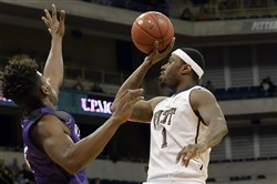 Pitt's Jamel Artis drives to the net against Niagara's Dayjar Dickson during a game earlier this season at the Petersen Events Center.