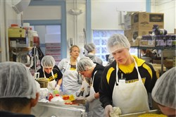 North Allegheny wrestlers participated in a service project at the Light of Life Mission. The boosters bought the food, and the kids cooked and served people.