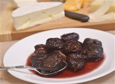 Figs poached in wine, served along with an assortment of cheeses.