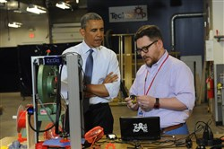 President Obama listens as Andy Leer gives a demonstration on a 3D printer during a visit to TechShop Pittsburgh in Bakery Square in June.