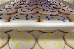 Freshly-iced Eat n' Park Smiley Cookies await packaging in the company's Robinson bakery.