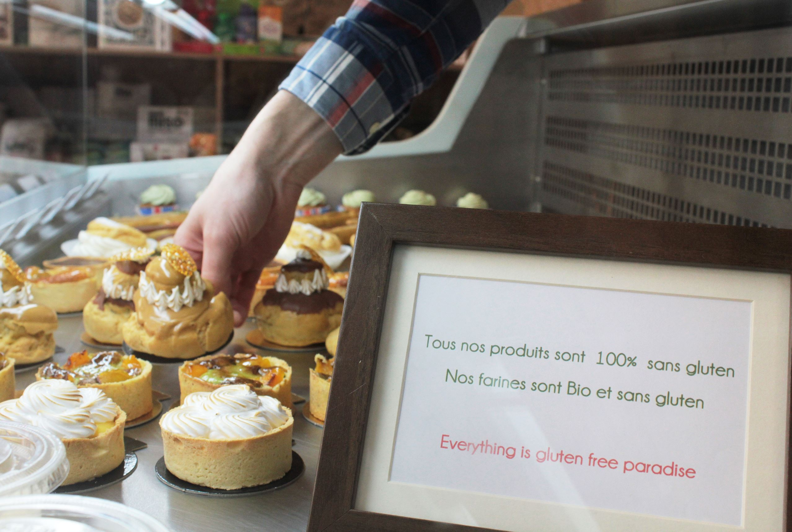 140940929 Gluten-free pastries are displayed in a specialized patisserie in Paris.