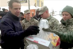 New York Gov. Andrew Cuomo talks with National Guard members who are helping stranded motorists today in Cheektowaga, N.Y.