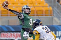 Pine-Richland quarterback Ben DiNucci gets a pass off as he's pressured by Central Catholic's Bryan Glover in the first half of the WPIAL class AAAA championship at Heinz Field.