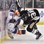 The Penguins' Zach Sill levels New York Islander Frans Nielsen in the first period Friday night at Consol Energy Center.