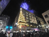Pittsburgh's 54th annual Light Up Night and the annual lighting of the Highmark Unity Tree, with fireworks overhead.