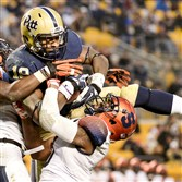 Pitt's Dontez Ford pulls in a pass for a touchdown as he's defended by Syracuse's Ritchy Desir and Darius Kelly in the second quarter at Heinz Field Saturday.