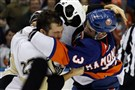 Penguins' Steve Downie fights with Travis Hamoni of the New York Islanders in the first period Saturday at Nassau Coliseum in Uniondale, New York.