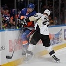 Craig Adams drives New York's Thomas Hickey into the boards in the Penguins' game against the Islanders in Uniondale, N.Y., Saturday night — the second game of a weekend home-and-home series.