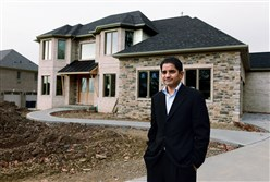 LalithKumar Solai, a University of Pittsburgh psychiatrist born in India, stands in front of the home he and his wife are having built in McCandless. The home has several features that comply with Hindu religious standards, including a main door facing east and a prayer room on the main floor.