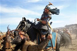 "Christian Bale as Moses charges into a fierce battle in ""Exodus: Gods and Kings."""