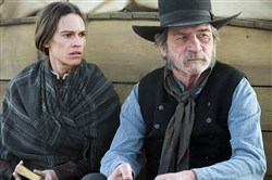 "Hilary Swank and Tommy Lee Jones star in ""The Homesman."""