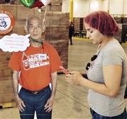 "More than 2,000 visitors a day took the free Sriracha sauce-making tour during fall ""grinding season"" at Huy Fong Foods in Irwindale, Calif. They could pose with a cardboard cutout of CEO David Tran."
