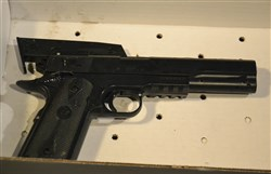 "This replica gun was taken from a 12-year old boy who was shot by Cleveland police. The boy died from his wounds Sunday, a day after officers responded to an emergency call about a someone waving a ""probably fake"" gun at a playground. Police described the weapon as an ""airsoft"" type replica that resembled a semi-automatic handgun."