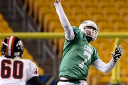 South Fayette quarterback Brett Brumbaugh gets a pass off against Aliquippa in the first half of the WPIAL Class AA championship game at Heinz Field last Friday.