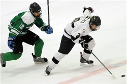 Jordan Timmons, left, played three years for South Fayette. He has committed to play at Connecticut after he finishes junior hockey.