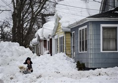 A man digs snow following a massive snow storm in Buffalo Sunday.