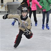 Colton Bechtold of Penn Hills, then 8, shows off his skating skill on at the Ice rink at PPG Place last November.