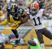 Steelers' Ike Taylor breaks up a pass intended for Browns' Travis Benjamin in a September game at Heinz Field.