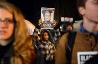 Vespera Barrow, 28, of Brentwood stands with a crowd of more than 100 at a solidarity rally Tuesday night in Oakland.