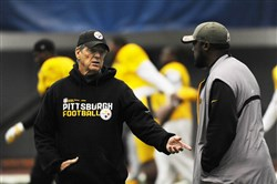 Defensive coordinator Dick LeBeau, left, speaks with Steelers coach Mike Tomlin in preparation for their game against the Saints last week.