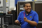 Carvis Fisher of the East End gets pumped for the arrival of customers at the 5 p.m. opening of Best Buy in Ross Township today.