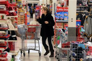 Melissa Allenbaugh of Jefferson Boro dashes through Kmart looking for advertised specials.