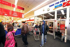 Kmart shoppers open the store on Route 51 in Pleasant Hills at 6 a.m. Thursday.