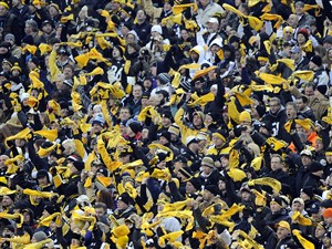 Steelers fans wave their towels as their team takes on the Ravens at Heinz Field.