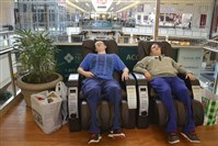 Devon Little and Danny Wallace, both of Salineville, Ohio, take a break from shopping today for a $2 massage at the Mall at Robinson. They had been shopping since 5 a.m.