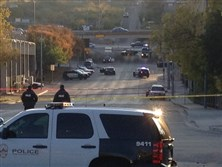Police tape marks off the scene after authorities shot and killed a man who they say opened fire on the Mexican Consulate, police headquarters and other downtown buildings early today in Austin, Texas.