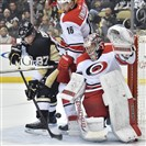 Carolina goalie Cam Ward stops Sidney Crosby in front by in the first period at the Consol Energy Center.
