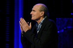 James Taylor enters and greets the crowd at Consol Energy Center before his performance.