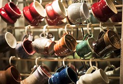 David Cooper mugs are at the 2014 Sweetwater Center for the Arts Holiday mART taking place through Sunday.