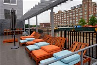 The raised deck alongside the swimming pool at Bakery Living includes a view of Bakery Square across the street, as shown last May.