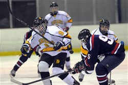 Thomas Jefferson's Casey Bilski, left, and McDowell's Dan Smith fight for the puck Dec. 4 in Bethel Park.