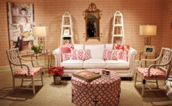 Dana Gibson introduced her new line of upholstered furniture at the Fall High Point Market. The Church Hill sofa and Richmond ottoman are flanked by her Oliver arm chairs.