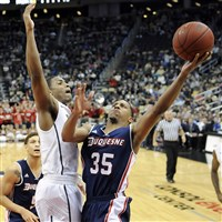 Duquesne's Jordan Stevens drives to the net against Pitt's Chris Jones in the first half at Consol Energy Center.