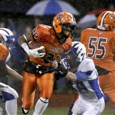 Clairton's Lamont Wade is tackled by Sharpsville's George Keck during a PIAA Class A semifinal  at North Allegheny High School.