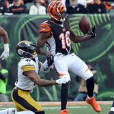 The Bengals' A.J. Green pulls in a pass as he's defended by Steelers cornerback Antwon Blake in the fourth quarter at Paul Brown Stadium Sunday afternoon.