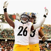 Steelers running back Le'Veon Bell celebrates his touchdown in the fourth quarter against the Bengals at Paul Brown Stadium.